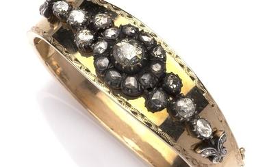 A 14k gold and silver diamond bangle