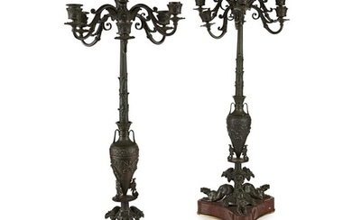 A 19TH CENTURY PAIR OF PATINATED BRONZE GRAND TOUR CANDELABR...