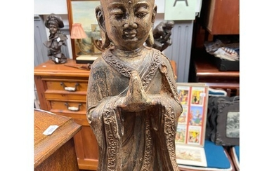 A 19th century Chinese cast iron Monk figure.Showing signs o...