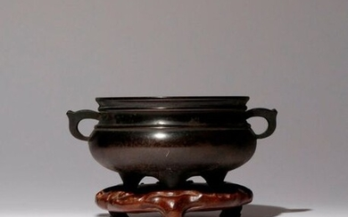 A CHINESE BRONZE TRIPOD INCENSE BURNER QING DYNASTY The compressed...