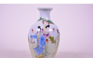 A Chinese porcelain vase decorated with ladies in a garden s...