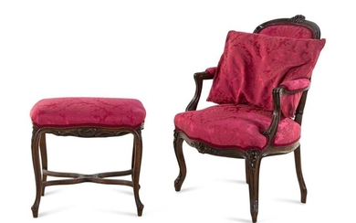 A Louis XV Style Carved Walnut Fauteuil and Tabouret