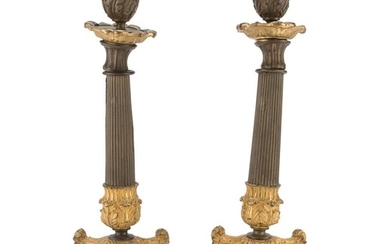 A PAIR OF CANDLESTICKS IN BURNISHED AND GILDED BRONZE - EMPIRE PERIOD