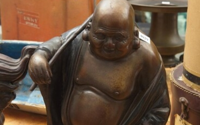 A PATINATED IRON BUDDHA FIGURE WITH STICK ACROSS SHOULDER, H.44CM, LEONARD JOEL LOCAL DELIVERY SIZE: SMALL