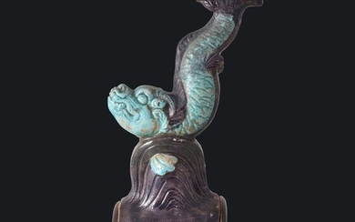 A TURQUOISE & AUBERGINE ROOF-TILE DEPICTING A FIGURE OF A LEAPING FISH - Pottery - China - Ming Dynasty (1368-1644)