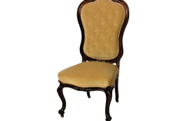 A Victorian carved walnut balloon back side chair, the mould...