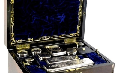 A Victorian rosewood and pewter strung dressing case, the hi...