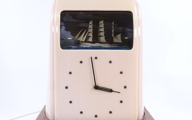 A Vitascope pink Bakelite-cased clock, circa 1930s, with rol...