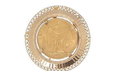 A gold piece of 20 FF Génie 1878 mounted as a brooch and pendant on 18 K (750 °/°°) yellow gold Gross