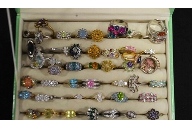 A large collection of gold and metal stone set dress rings, ...
