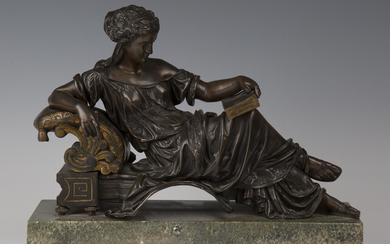 A late 19th century French brown and gilt patinated cast bronze figure of a Classical lady relaxing