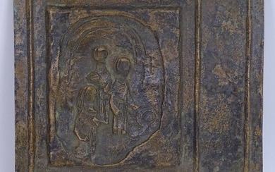 A late 20th century cast-brass religious plaque, relief and ...