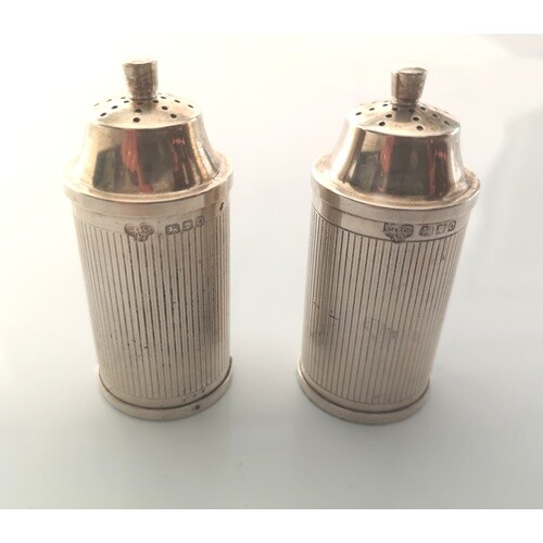 A pair of George VI sterling silver Condiments. Goldsmiths a...
