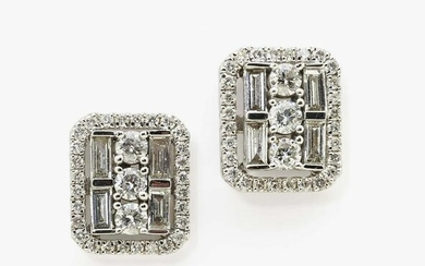 A pair of stud earrings with brilliant cut diamonds and