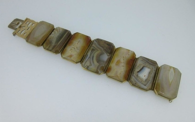 A panel bracelet of banded and spotted agates,