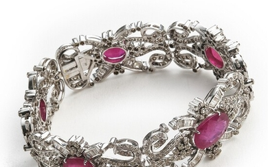 A ruby and diamond bracelet set with numerous oval-cut rubies and brilliant and trapeze-cut diamonds, mounted in 18k white gold. L. app. 19.0 cm. Circa 1940–50.