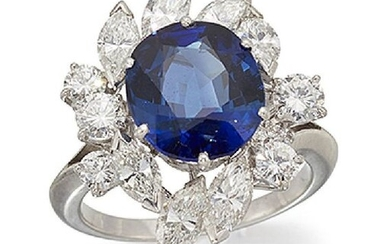 A sapphire and diamond cluster ring, the central...