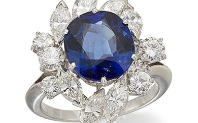 A sapphire and diamond cluster ring, the...