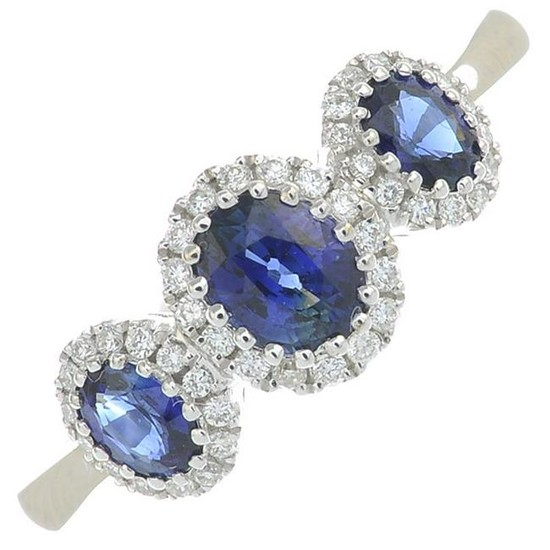 A sapphire and diamond ring.Total sapphire weight