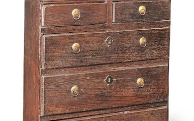 A small Queen Anne oak 'table-top' chest of drawers, circa 1710