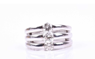 A white metal and diamond triple band ring, inset with three...