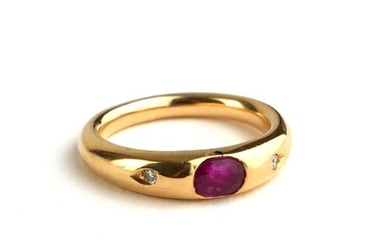 AN 18CT GOLD, RUBY AND DIAMOND RING The single oval cut ruby...