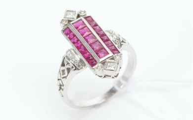 AN ART DECO STYLE RUBY AND DIAMOND PLAQUE RING IN 18CT WHITE GOLD, LENGTH OF THE PLAQUE 23MM, SIZE P, 5.6GMS