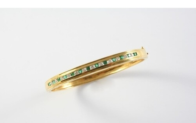 AN EMERALD, DIAMOND AND GOLD HALF HINGED BANGLE the gold ban...