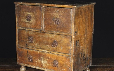 An 18th Century Miniature Painted Chest of Drawers. The two short and two long drawers fitted with i