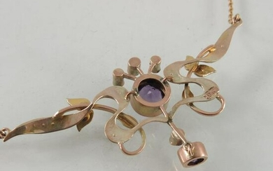 An Arts and Crafts 9 carat gold, amethyst and seed