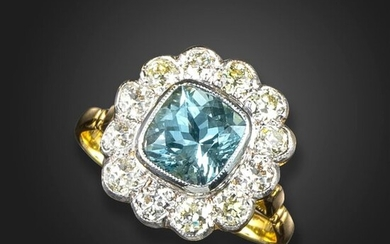 An aquamarine and diamond cluster ring, the square cushion-shaped aquamarine is set within a surround of old circular-cut diamonds in platinum and gold, size N 1/2