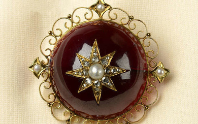 An early 20th century 15ct gold garnet brooch, with split pearl and rose-cut diamond star inset.