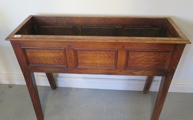 An oak planter with three panel front, 72cm tall x 95cm x 34...