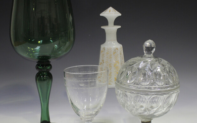 An oversize green tinted wine glass, late 19th/early 20th century, the rounded bowl on a hollow balu
