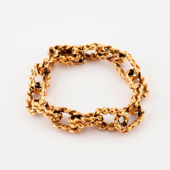 Bracelet in yellow gold (750) with braided forçat links.
