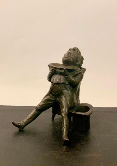 Cast iron inkwell imitating bronze, depicting a man at the barber's. Height 12 cm