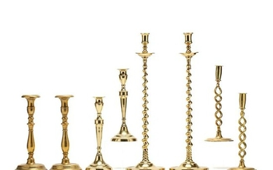 Four Pairs of Antique Brass Candlesticks