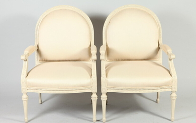 PAIR LOUIS XVI STYLE CARVED AND CREAM PAINTED DOMED BACK...