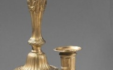 Pair of chased bronze torches; the bobèches with...