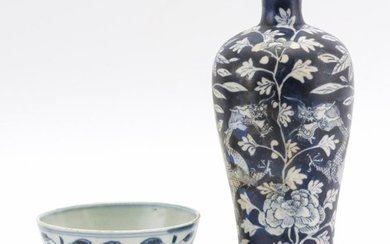 """TWO PIECES OF CHINESE BLUE AND WHITE PORCELAIN 1) Footed bowl with underglaze lotus design. Height 2.25"""". 2) Matte blue meiping-form..."""