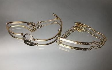 Two gold bracelets, one engraved Simone, the other...
