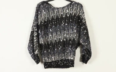 VINTAGE BLACK, GREY AND SILVER SEQUINED SWEATER. Estimate $60-80
