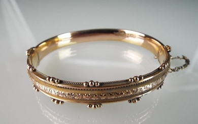 9ct Fancy gold Bangle with safety chain. 9.3g