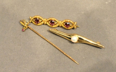A 15 Carat Gold Triple Bar Brooch, garnet set, together with...