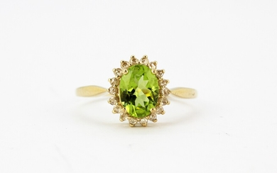 A 9ct yellow gold oval cut peridot and rose cut diamond set cluster ring, (M).