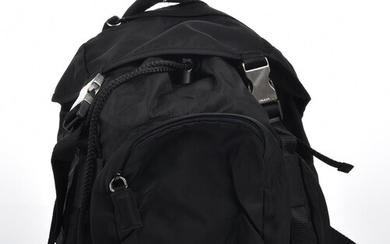 A BACKPACK BY PRADA-Styled in black nylon with silver metal hardware, 22 x 23 x 16cm.