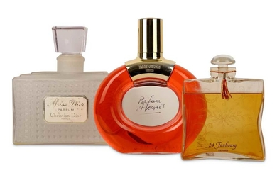 A COLLECTION OF THREE OVER-SIZED GLASS PERFUME BOTTLES
