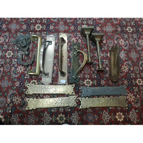 A COLLECTION OF VICTORIAN AND LATER BRASS DOOR FURNITURE Com...