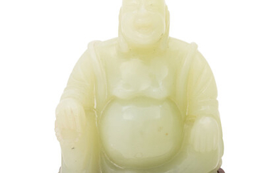 A Chinese Serpentine Figure of a Laughing Buddha