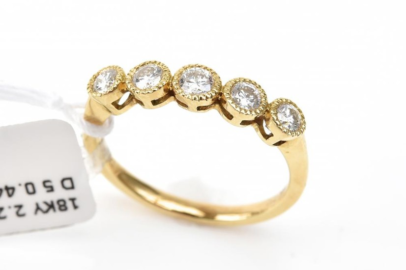 A DIAMOND ETERNITY RING - Set with five round brilliant cut diamonds totalling 0.44ct, in 18ct gold, ring size N.